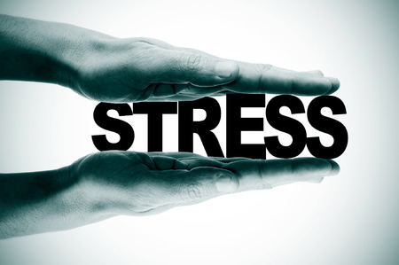 competitiveness: man hands pressing the word stress in black and white Stock Photo