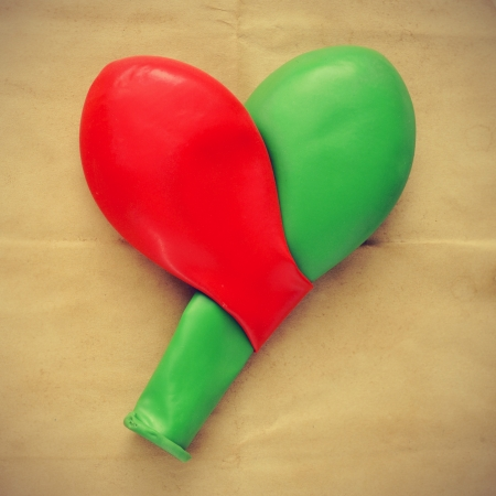 picture of two balloons forming a heart on an old paper background with a retro effect photo