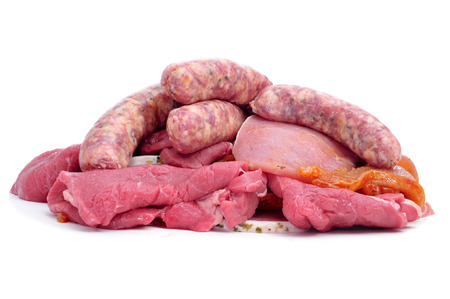 chorizos: a pile of a raw meat assortment, with beef and turkey fillets and pork meat sausages, on a white background