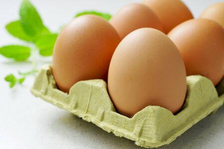 god box: closeup of some chicken eggs in a carton