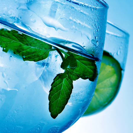 addictive drinking: closeup of some glasses with gin and tonic
