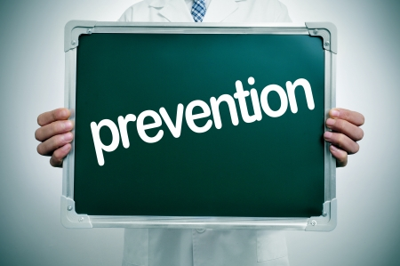preventive: a doctor in white coat showing a chalkboard with the word prevention written in it Stock Photo