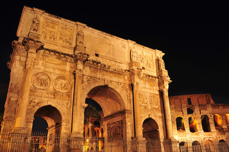 constantine: view of the Arch of Constantine and the Coliseum at night in Rome, Italy Editorial