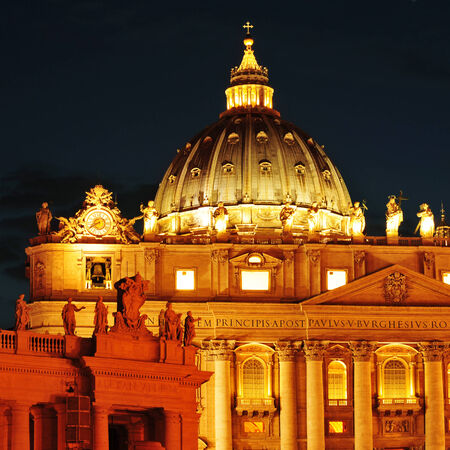 view of the Basilica of Saint Peter, in Vatican City, Italy at night photo