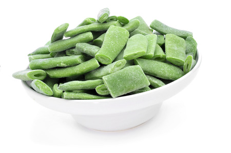 french bean: a bowl with frozen chopped green beans on a white background