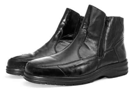 footgear: a pair of black leather boots for man on a white background