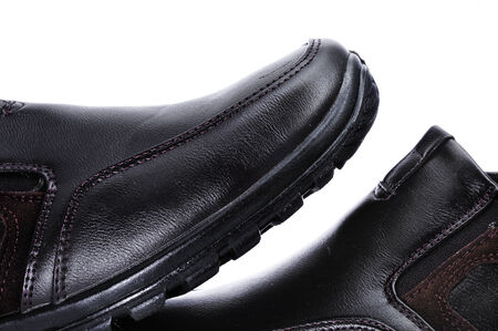 footgear: closeup of a pair of casual shoes for man on a white background
