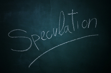 speculation: word speculation written with chalk in a chalkboard Stock Photo