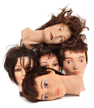 some different mannequin heads on a white background photo
