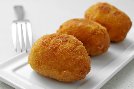 croquettes: closeup of a plate with croquetas, spanish croquettes, on a granite worktop Stock Photo