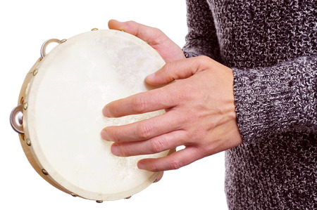 someone playing a tambourine over a white background photo