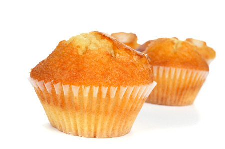 madalena: some homemade magdalenas, typical spanish plain muffins, on a white background