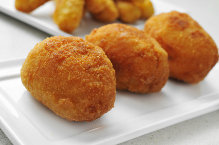 closeup of a plate with croquetas, spanish croquettes, on a set table Zdjęcie Seryjne