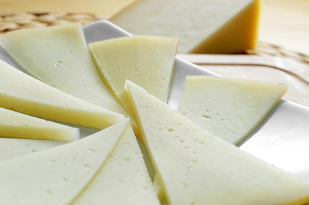 wedge: closeup of some slices of manchego cheese from Spain