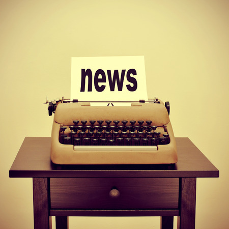 publishes: picture of an old typewriter with a page with the word news written in it, with a retro effect