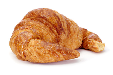 a croissant on a white background photo