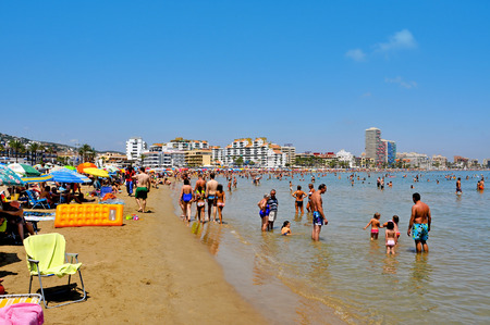 bathers: PENISCOLA, SPAIN - JULY 26: Bathers in North Beach on July 26, 2013 in Peniscola, Spain. The town is a typical summer destination facing the Mediterranean Sea, in the North of the Valencian Community Editorial
