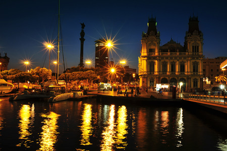 BARCELONA, SPAIN - AUGUST 20: Port Vell and Columbus Monument at night on August 20, 2013 in Barcelona, Spain. It is a 60 meters tall monument for Christopher Columbus at the lower end of La Rambla