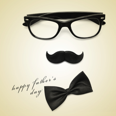 sentence happy fathers day and glasses, mustache and bow tie forming a man face in a beige , with a retro effect
