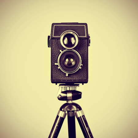 picture of an old camera in a tripod with a retro effect photo