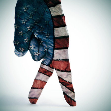 a man hand with its fingers painted as american flag simulating someone walking photo