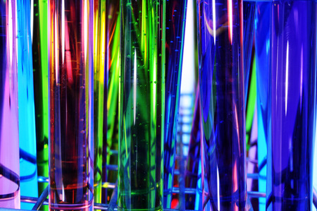 biologist: closeup of a pile of test tubes with liquids of different colors