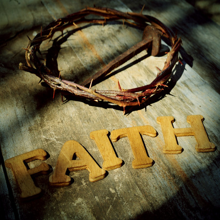 word faith and the Jesus Christ crown of thorns and a nail in the holy cross photo