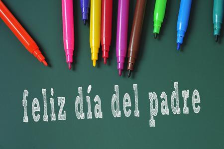 del: feliz dia del padre, happy fathers day written in spanish in a chalkboard