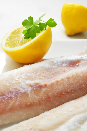 hake: closeup of a plate with some frozen hake fillets Stock Photo