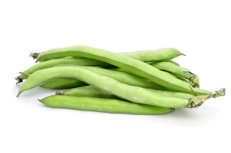 fava: a pile of broad bean pods on a white background  Stock Photo