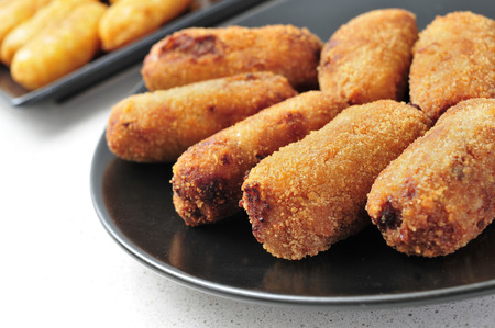 breadcrumbs: closeup of a plate with croquetas, spanish croquettes