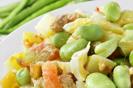 fava: closeup of a salad with raw broad beans, tomato, tuna, boiled potato and boiled egg Stock Photo