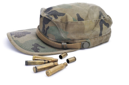 pointed arm: a camouflage cap and some con a white background