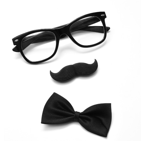 a pair of glasses, a mustache and a bowtie on a white  photo