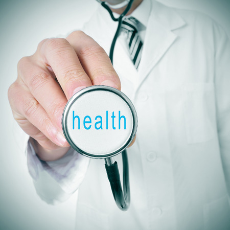 doctor with a stethoscope with the word health written in it photo