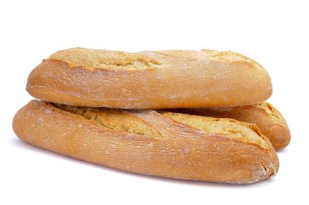 panino: algunos baguettes demi o bollos de pan en un fondo blanco Foto de archivo