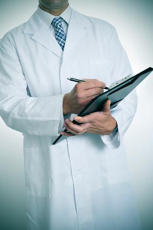 prescribe: a doctor writing in a clipboard