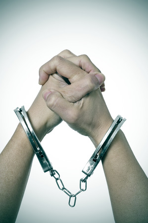 a woman with handcuffs in her wrists