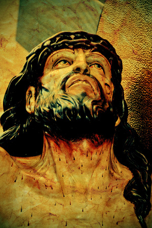 a figure of Jesus Christ in the Holy Cross, with a retro effect photo