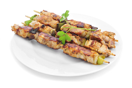 kitchen spanish: closeup of a plate with grilled chicken and vegetables skewers Stock Photo