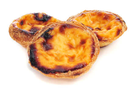 some pasteis de nata, typical Portuguese egg tart pastries, on a white background photo