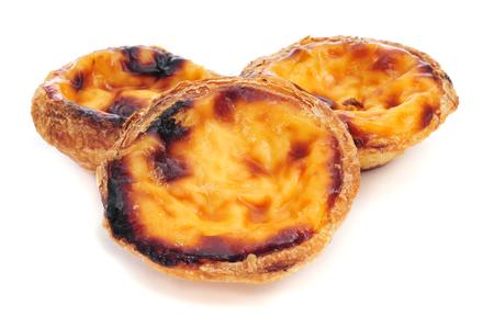 nata: some pasteis de nata, typical Portuguese egg tart pastries, on a white background