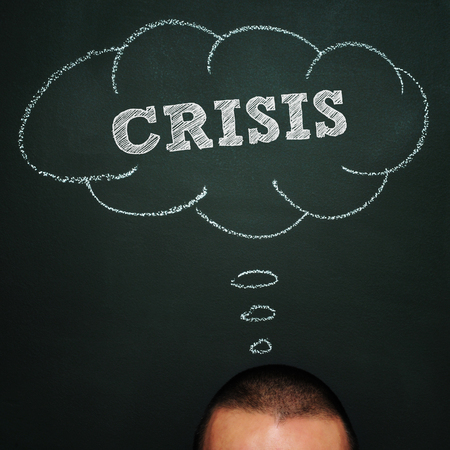 credit crisis: a man over a blackboard with a thought bubble drawn in it and the word crisis, depicting the idea of being worried about it