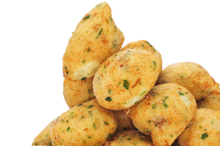 bacalao: a pile of bunuelos de bacalao, spanish cod fritters, on a white background