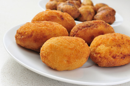 kitchen spanish: closeup of a plate with croquetas, spanish croquettes