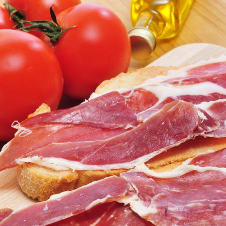 pa: closeup of spanish pa amb tomaquet, bread with tomato, with serrano ham