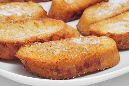 lent: closeup of a plate with torrijas, typical spanish dessert for Lent and Easter