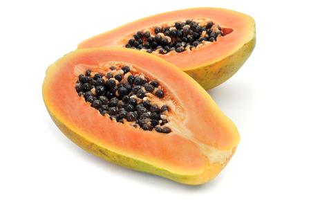 halved: a halved papaya on a white background Stock Photo