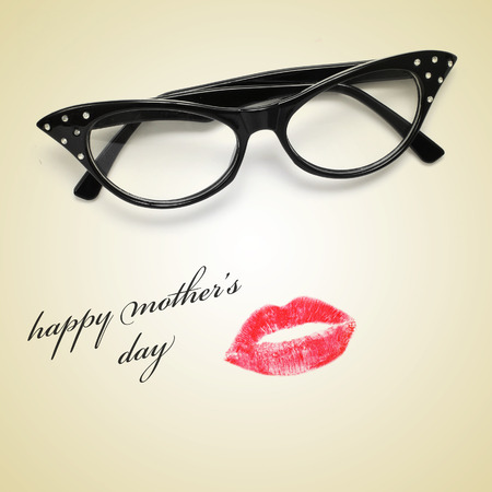 a pair of glasses and a lipstick mark forming a woman face and the sentence happy mothers day  photo