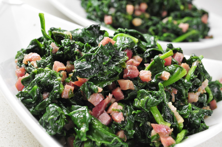 sautee: some bowls with spanish espinacas con jamon, spinach with ham Stock Photo